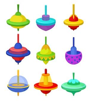 Flacher satz bunter wirbelstürme. klassisches kinderspielzeug. kunststoff-kreisel auf weißem hintergrund