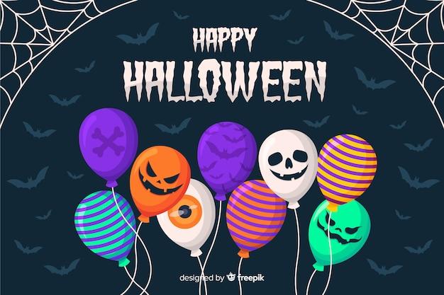 Flaches design des halloween steigt hintergrund im ballon auf