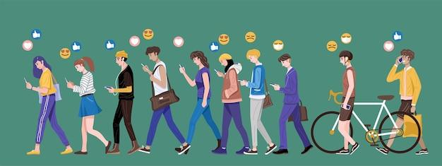 Flaches design, gruppe junger leute, die smartphones verwenden, die emojis senden und empfangen.