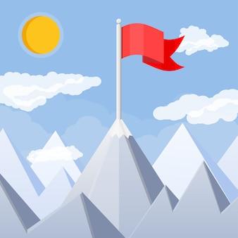 Flagge auf dem gipfel des berges.