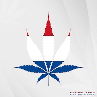 Flagge der niederlande in marihuana-blattform. das konzept der legalisierung von cannabis in den niederlanden.