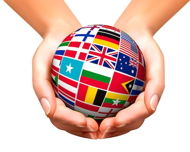 Flaggen der welt in globus und händen.