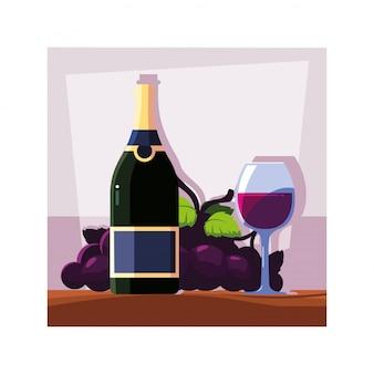Flasche und glas wein mit trauben