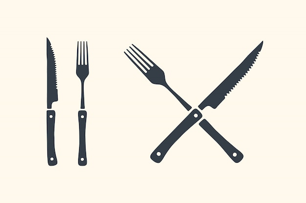 Fleischschneidemesser und gabeln eingestellt. steak, metzger und grillzubehör