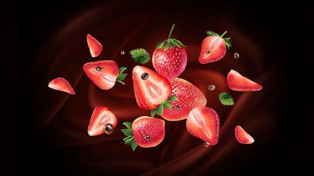 Fliegende frische erdbeeren auf einem schokoladenhintergrund.