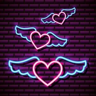 Fliegende geflügelte herzen, backsteinmauer, neonstil