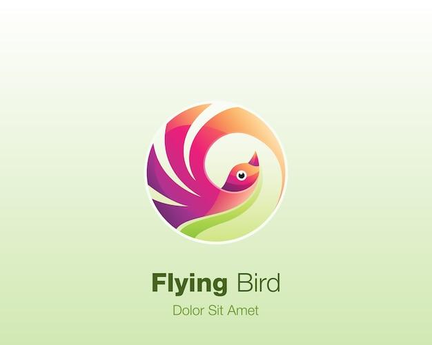 Fliegender vogel. buntes kreisvogelikonenlogo