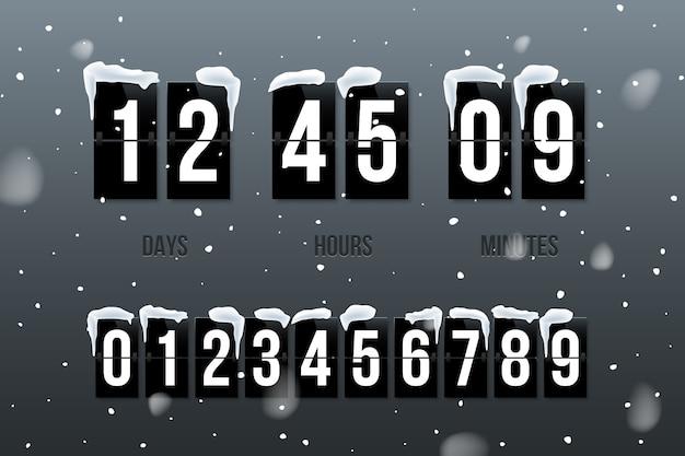 Flip countdown zeigt tage, stunden und minuten auf schneehintergrund mit festgelegten zahlen.