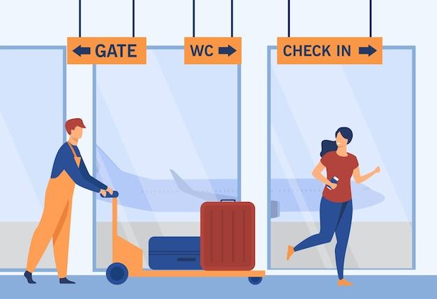 Flughafenarbeiter und passagier gehen zum flugzeug.