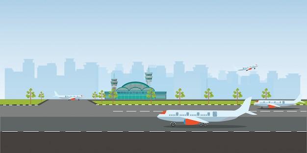 Flughafengebäude und flugzeuge auf landebahn.
