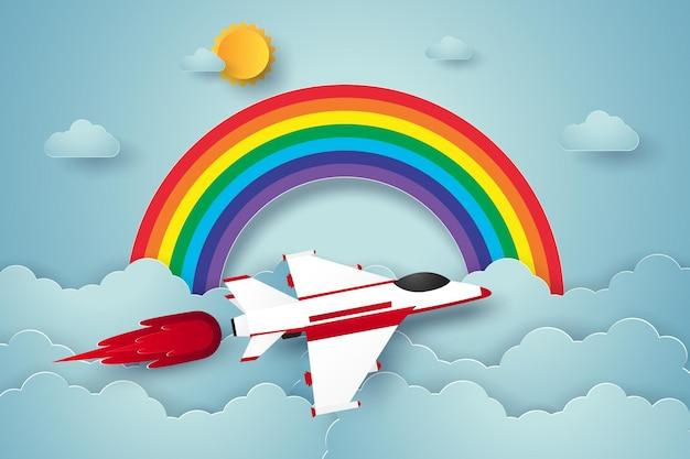 Flugzeug fliegt am blauen himmel mit regenbogen im papierkunststil