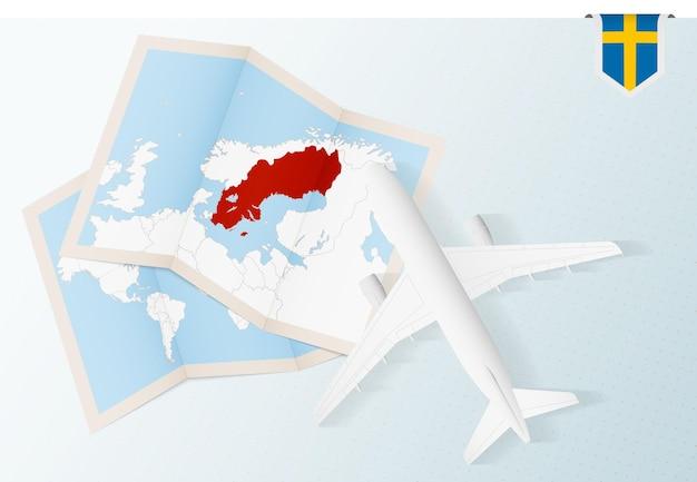 Flugzeug mit karte und flagge von schweden