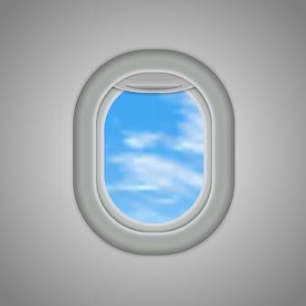 Flugzeuge, flugzeugfenster mit bewölktem blauem himmel draußen.