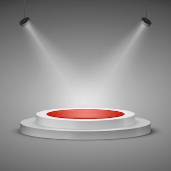 Flutlichtbühne. beleuchtete bühnenpodest-szene mit rotem teppich. belohnung des gewinners.