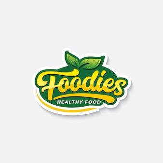 Foodies-typografielogo oder -aufkleber für gesundes lebensmittel