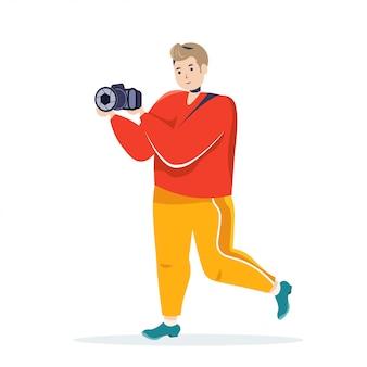 Fotograf, der digitalkameramann verwendet, der foto-typ in der männlichen zeichentrickfigur der lässigen trendigen kleidung nimmt