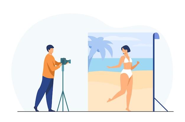 Fotoshooting der frau, die im strand aufwirft