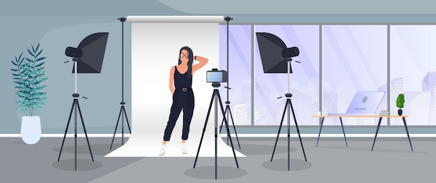 Fotostudio-vektor. mädchen, das zur kamera aufwirft. weißer leinwandhintergrund auf stativen. kamera auf stativ, softbox. professionelles fotostudio.