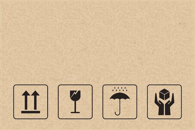 Fragiles zeichen und symbol auf braunem papier.