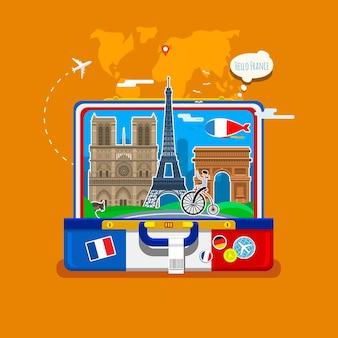 Französische flagge mit sehenswürdigkeiten im offenen koffer