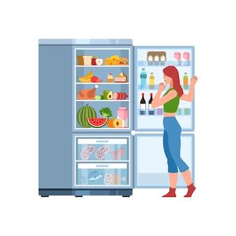 Frau am kühlschrank. weibliche figur, die im offenen, vollen kühlschrank mit verschiedenen produkten wasser, milch, obst und gemüse, fleisch zum kochen eines flachen vektorküchenkonzepts der gesunden ernährung sucht
