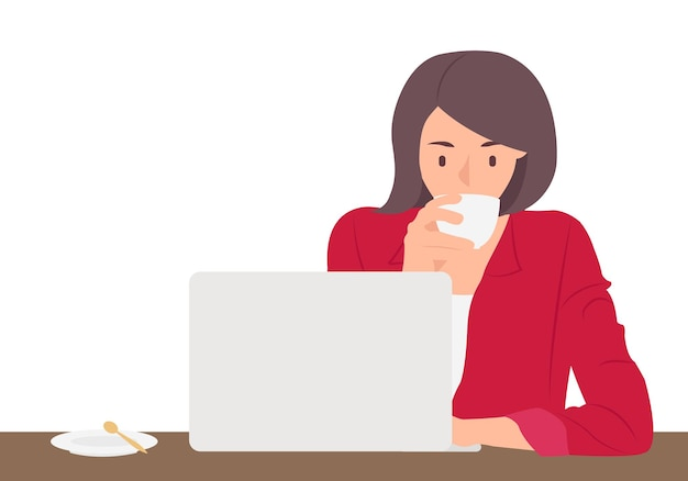 Frau arbeitet am laptop und trinkt kaffee