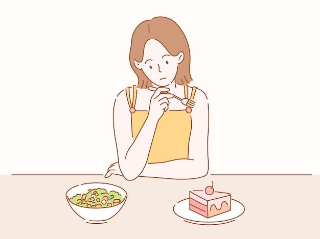 Frau auf diät und überlegt, welche gerichte sie essen soll