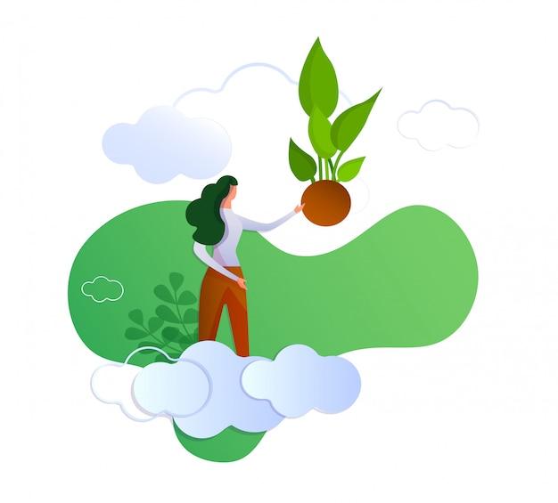 Frau auf wolke zeigend mit der hand auf grünem sprössling.