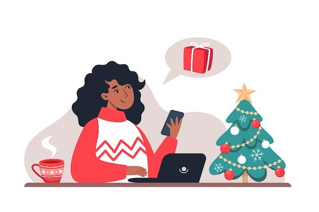 Frau beantwortet eine nachricht und kauft geschenke für die familie in einem online-shop, neujahr und weihnachten online-shopping von zu hause aus