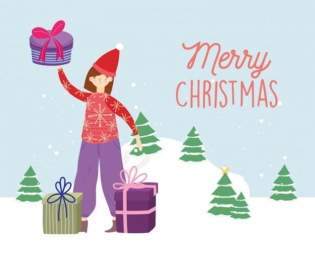 Frau der frohen weihnachten mit hässlicher strickjackengeschenkbaum-schneefeier