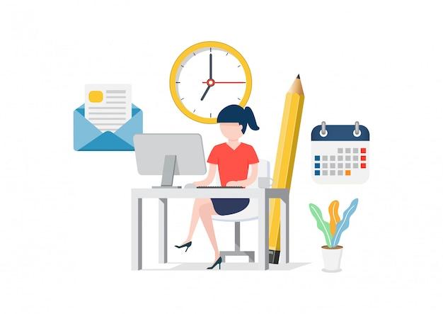 Frau, die am computer im büro sitzt.