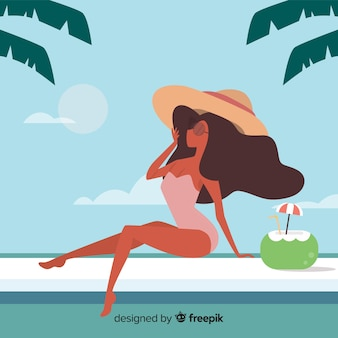 Frau, die am swimmingpool ein sonnenbad nimmt