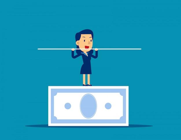 Frau, die auf der banknote balanciert