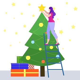 Frau, die auf der treppe verziert weihnachtsbaum steht