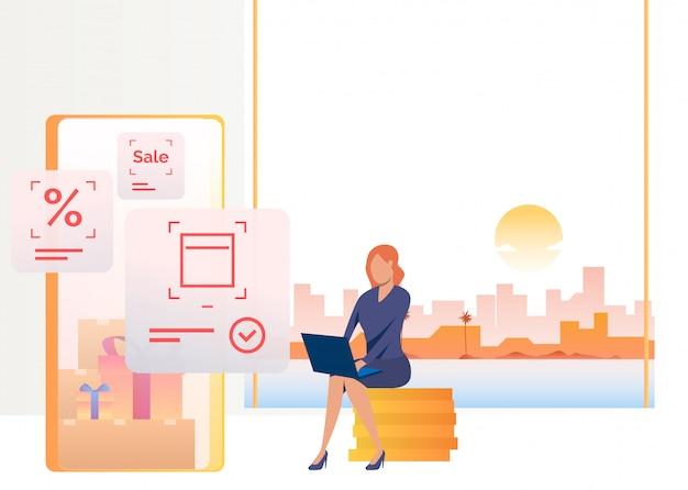 Frau, die auf münzenstapel sitzt und auf laptop kauft