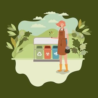 Frau, die baum im park mit papierkörben pflanzt
