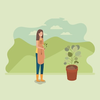 Frau, die baum im park pflanzt