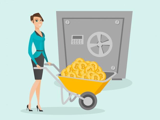 Frau, die bitcoins in der kryptokalten geldbörse hält.