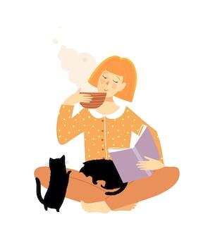 Frau, die buch liest und tee oder kaffee mit katzen trinkt.
