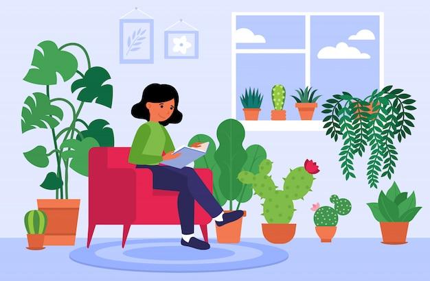 Frau, die buch zu hause unter zimmerpflanzen liest