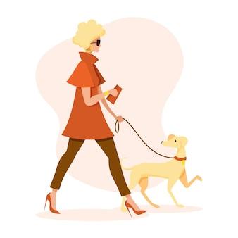 Frau, die den hund geht