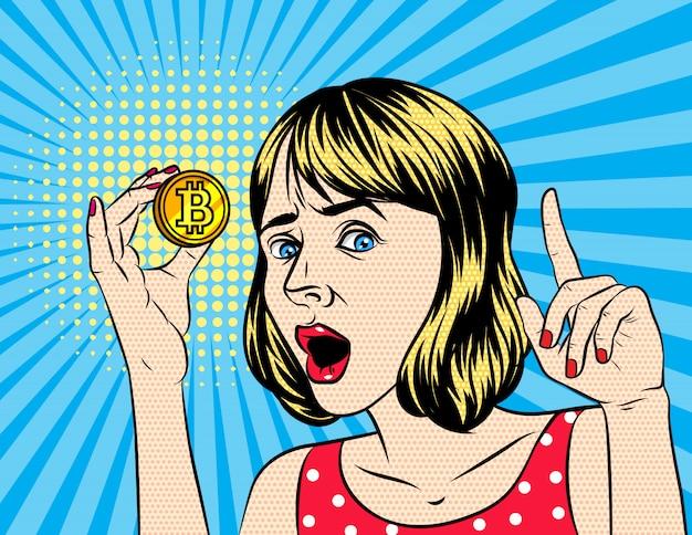 Frau, die ein bitcoin anhält