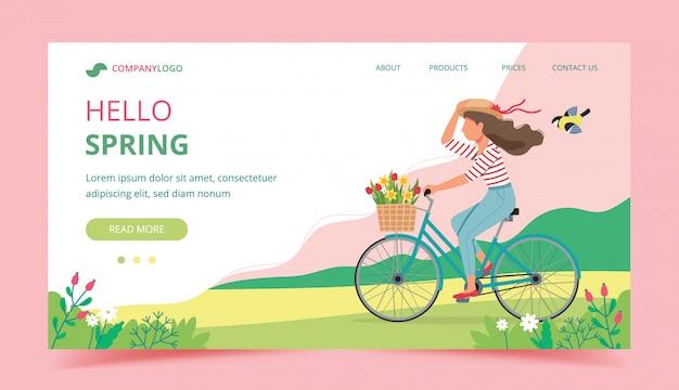 Frau, die ein fahrrad im frühjahr mit blumen im korb reitet.