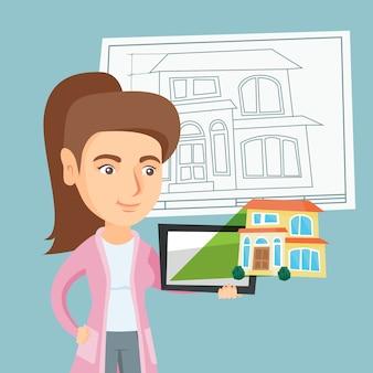 Frau, die eine digitale tablette mit hausfoto zeigt.