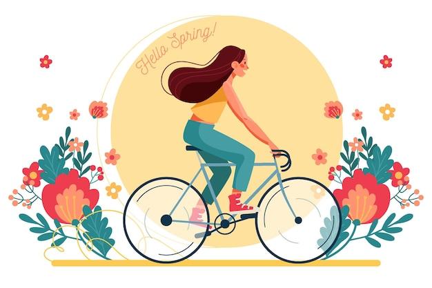 Frau, die einen fahrradfrühlingshintergrund reitet