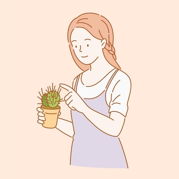 Frau, die einen kaktus im linienstil hält