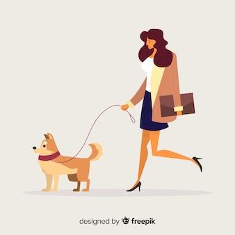 Frau, die einen spaziergang mit ihrem hund hat