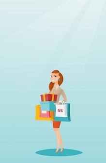 Frau, die einkaufstaschen und geschenkboxen hält.