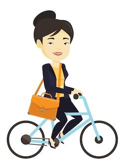 Frau, die fahrrad fährt.