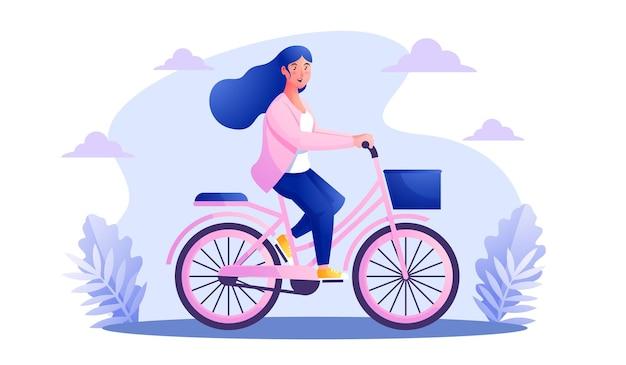 Frau, die fahrräder im park reitet